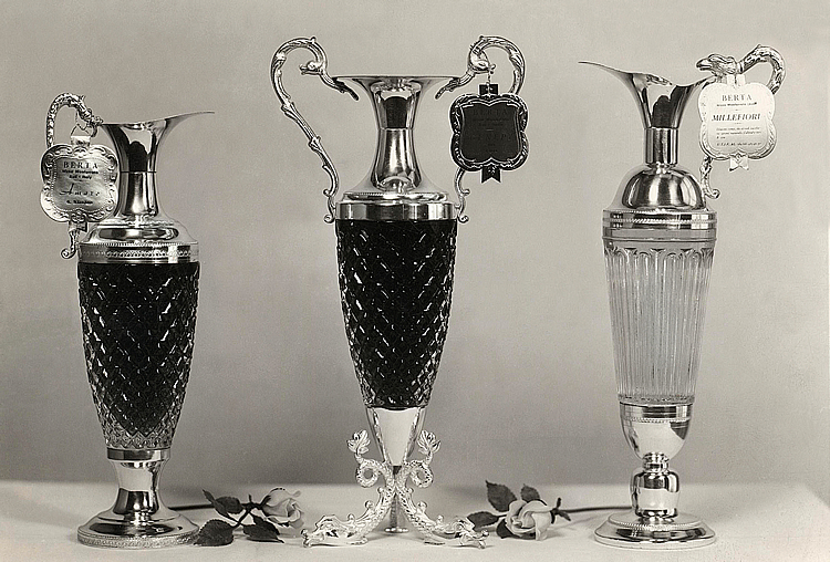 1961. The elegant silver and crystal bottles.